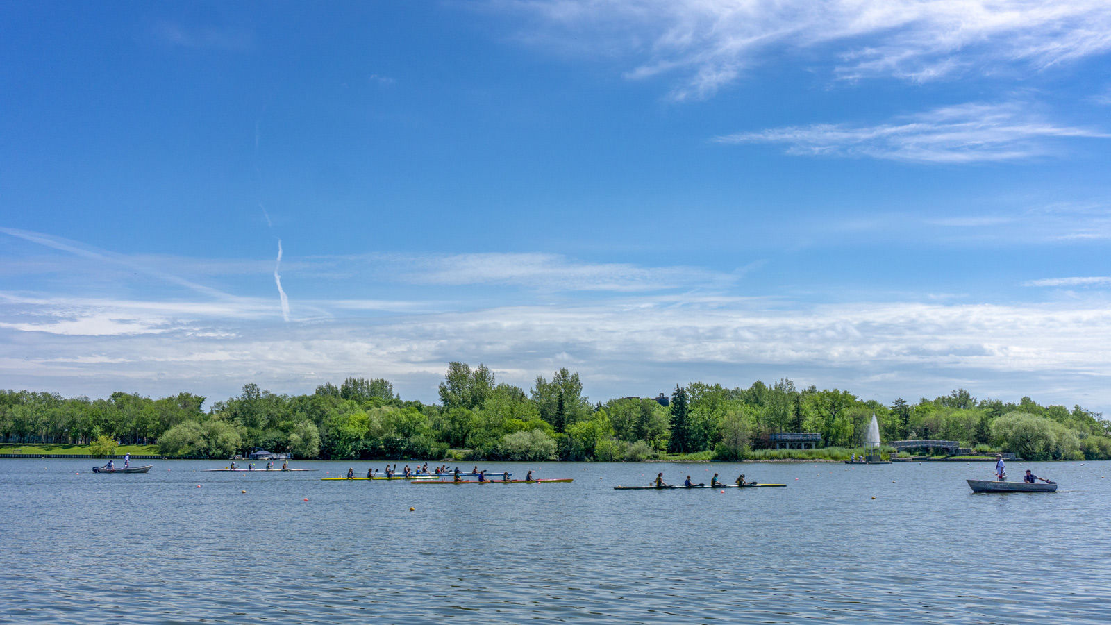 Rowers enjoy some quiet time on Wascana Lake near Regina hotels.
